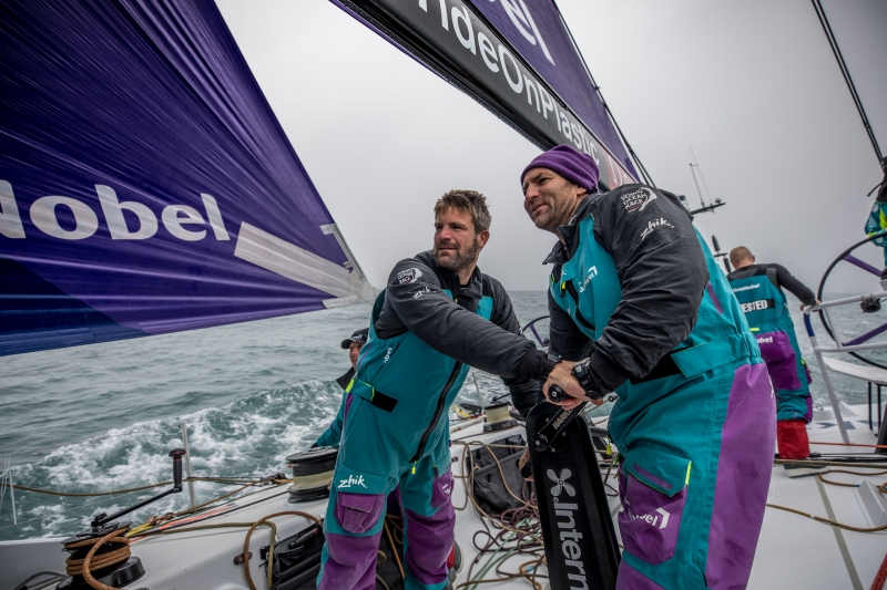 Leg 9, from Newport to Cardiff, day 8 on board Team AkzoNobel. Simeon Tienpont and Jules Salter share a smile while hoisting the new sail. 27 May, 2018.
